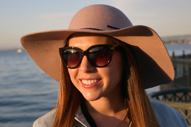 PINK FLOPPY HAT ON THE PIER
